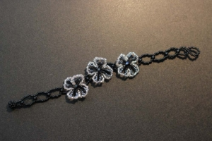 Bracelet - Black and Silver Beads with Three Silver Flowers