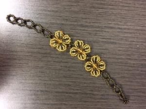 Bracelet - Brown and Gold Beads with Three Gold Flowers