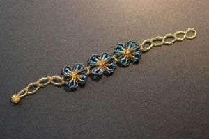 Bracelet - Gold and Blue Beads with Three Blue Flowers