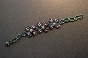 Bracelet - Green and Purple Beads with Three Purple Flowers